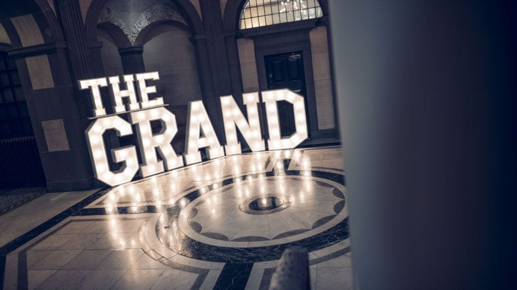 The Grand Illuminated Logo
